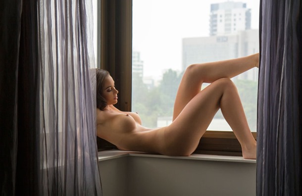 exposed at the window